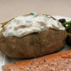 baked potato with butter  bacon bits  and sour cream and chives